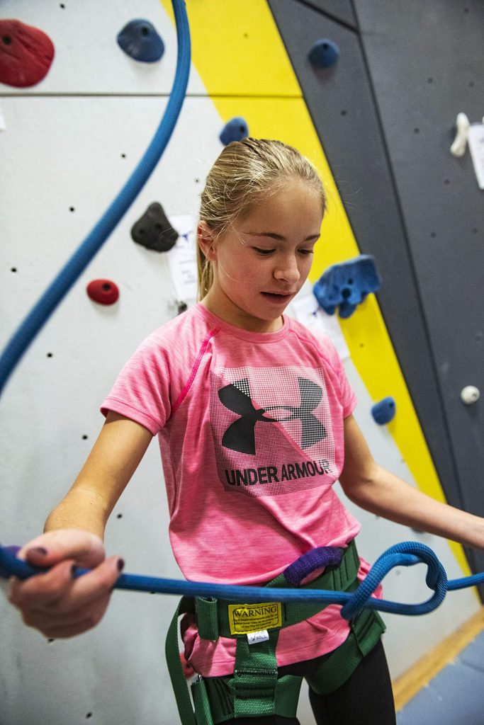 Ella Lahey, 14, practices her figure-eight knot during climbing team practice in the gym at Basalt High School on Wednesday, Nov. 6, 2019.
