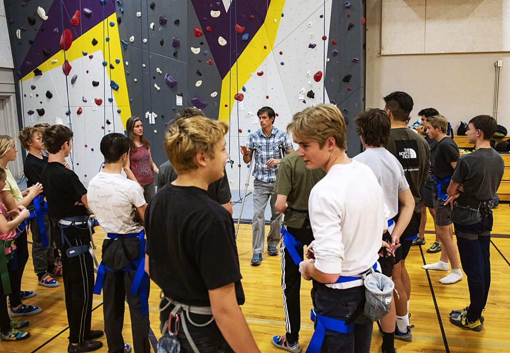Coach Tanner Jones, center, talks to his team before climbing practice in the gym of Basalt High School on Wednesday, Nov. 6, 2019.
