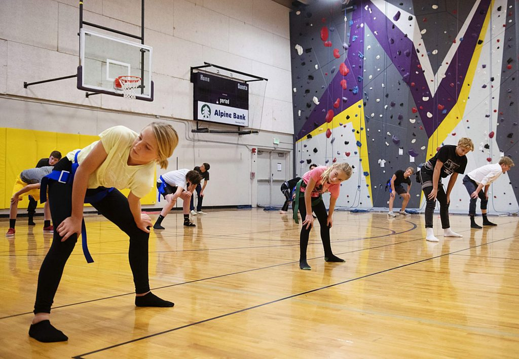 The Basalt High School climbing team warms up with stretches before practice in their gym on Wednesday, Nov. 6, 2019.