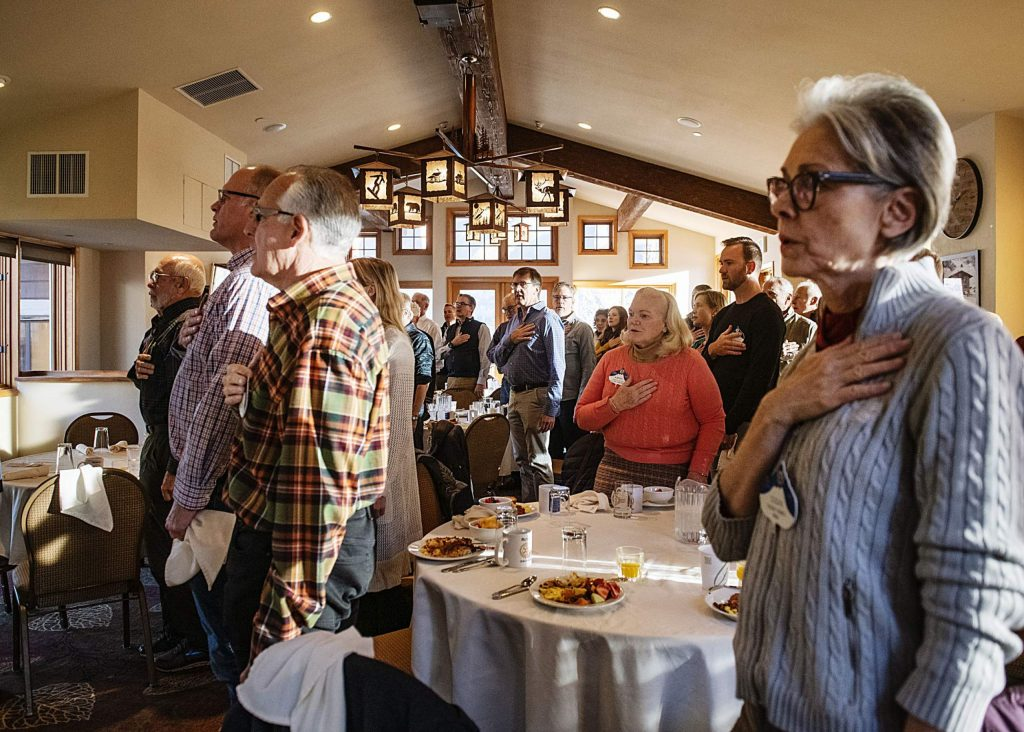 Aspen Rotarians say the pledge of allegiance at the beginning of their meeting in the Mountain Chalet on Thursday, November 7, 2019. (Kelsey Brunner/The Aspen Times)