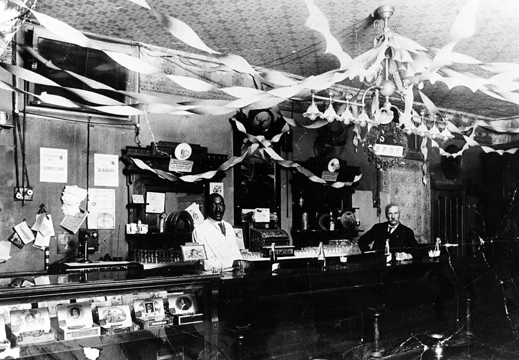 Hannibal Brown bartending at the Aspen Elks Lodge, circa 1910.