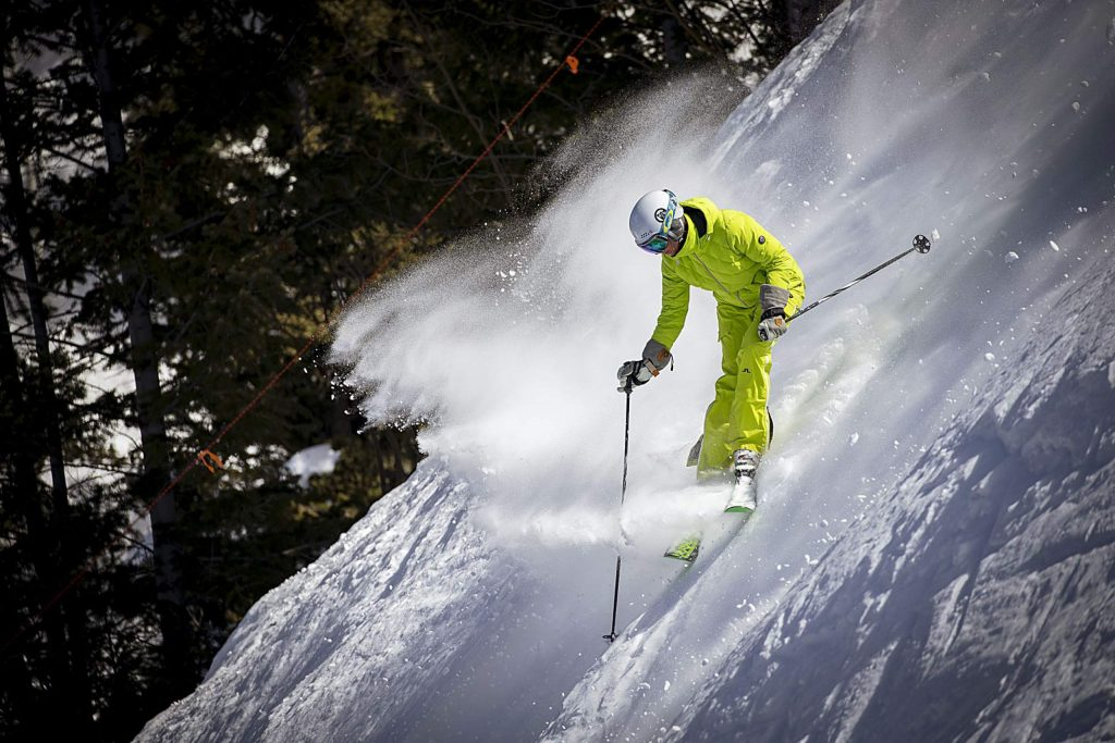 Kim Reichhelm skiing a steep line