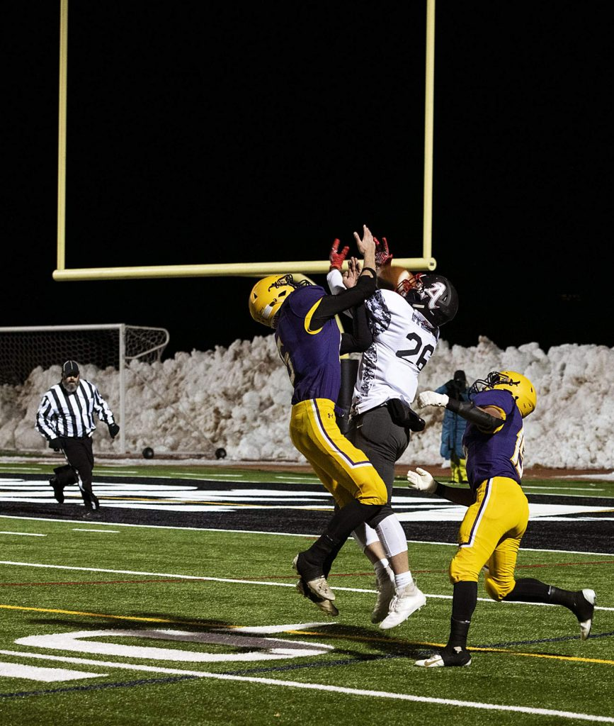 Basalt's Rulbe Alvarado (15) and Tristan Johnston (5) defend their end zone while Aspen's Max Ufkes (26) attempts to catch the pass during the game on Friday, November 1, 2019. (Kelsey Brunner/The Aspen Times)