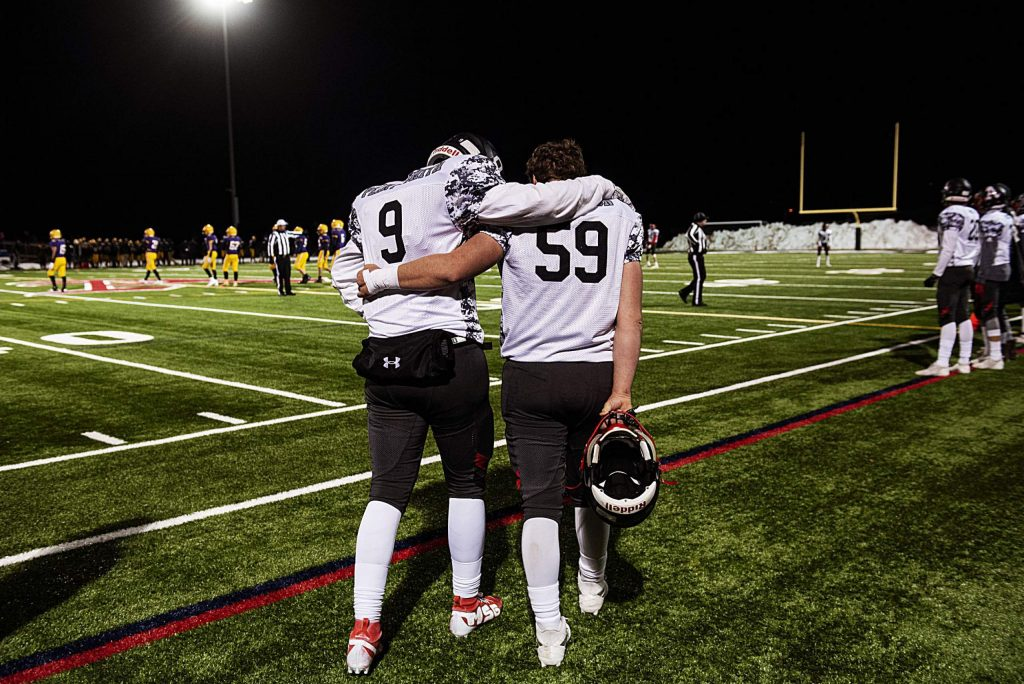 Aspen Skiers Storm Silich, left, and Marcus Gerbaz pray together on the sidelines during the fourth quarter of the game against Basalt on Friday, November 1, 2019. (Kelsey Brunner/The Aspen Times)