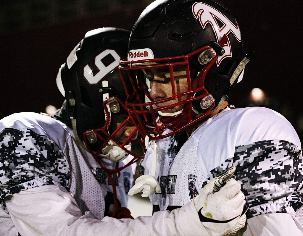 Aspen's Storm Silich and Charlie Williams say a prayer during the game against Basalt on Friday, November 1, 2019. (Kelsey Brunner/The Aspen Times)