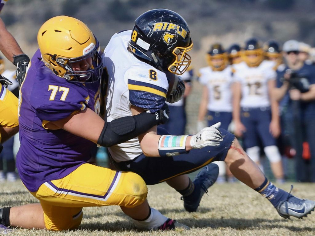 Basalt High School football's Ernesto Lopez, left, tackles Rifle's Levi Warfel in the backfield on Saturday, Nov. 16, 2019, on the BHS field. The Longhorns won the Class 2A state quarterfinal game in double overtime, 21-14. (Photo by Austin Colbert/The Aspen Times)