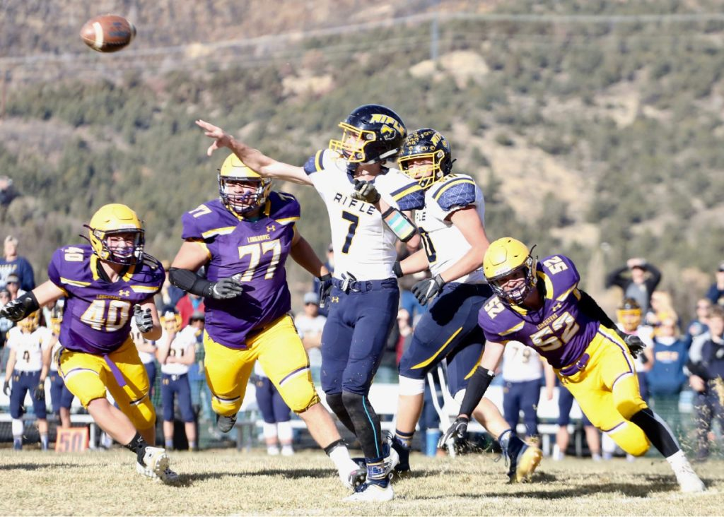 Rifle quarterback Holden Stutsman gets a pass off against Basalt on Saturday, Nov. 16, 2019, on the BHS field. The Longhorns won the Class 2A state quarterfinal game in double overtime, 21-14. (Photo by Austin Colbert/The Aspen Times)