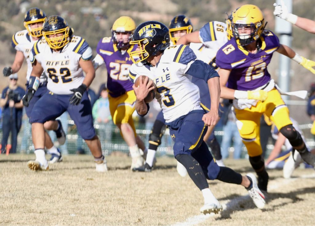 Rifle's Kenny Tlaxcala carries the ball against Basalt on Saturday, Nov. 16, 2019, on the BHS field. The Longhorns won the Class 2A state quarterfinal game in double overtime, 21-14. (Photo by Austin Colbert/The Aspen Times)