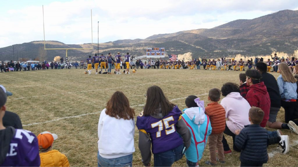 Basalt High School football fans and players circle up after the team knocked off Rifle on Saturday, Nov. 16, 2019, on the BHS field. The Longhorns won the Class 2A state quarterfinal game in double overtime, 21-14. (Photo by Austin Colbert/The Aspen Times)