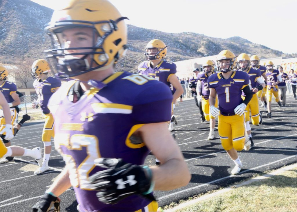 The Basalt High School football team runs onto the field prior to hosting Rifle on Saturday, Nov. 16, 2019, on the BHS field. The Longhorns won the Class 2A state quarterfinal game in double overtime, 21-14. (Photo by Austin Colbert/The Aspen Times)
