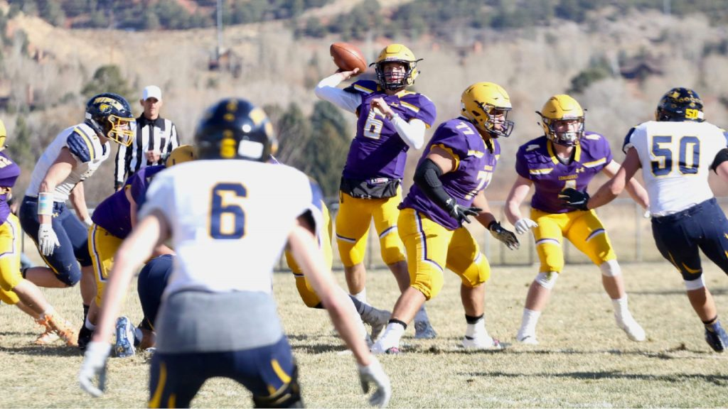 Basalt High School quarterback Matty Gillis prepares to throw against Rifle on Saturday, Nov. 16, 2019, on the BHS field. The Longhorns won the Class 2A state quarterfinal game in double overtime, 21-14. (Photo by Austin Colbert/The Aspen Times)