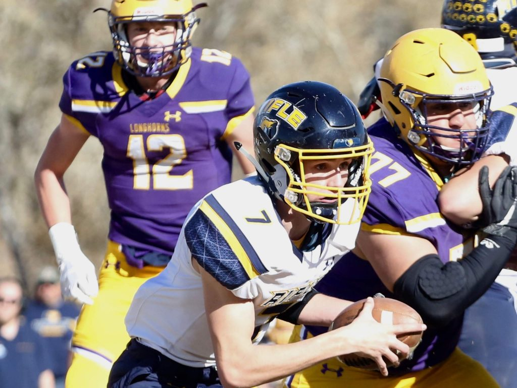 Rifle quarterback Holden Stutsman carries the ball against Basalt on Saturday, Nov. 16, 2019, on the BHS field. The Longhorns won the Class 2A state quarterfinal game in double overtime, 21-14. (Photo by Austin Colbert/The Aspen Times)