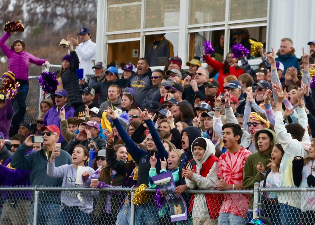 Basalt High School football fans cheer as the team hosts Rifle on Saturday, Nov. 16, 2019, on the BHS field. The Longhorns won the Class 2A state quarterfinal game in double overtime, 21-14. (Photo by Austin Colbert/The Aspen Times)