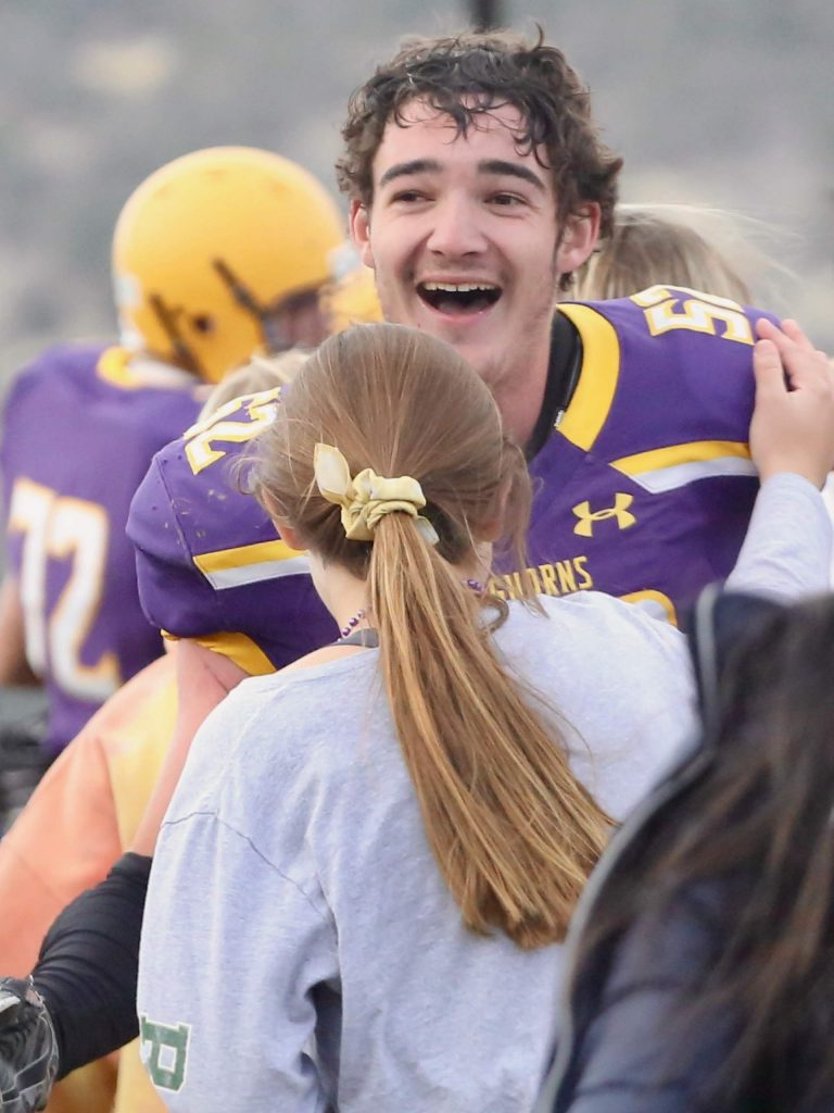 Basalt High School football's Lander McNamee laughs in celebration after beating Rifle on Saturday, Nov. 16, 2019, on the BHS field. The Longhorns won the Class 2A state quarterfinal game in double overtime, 21-14. (Photo by Austin Colbert/The Aspen Times)