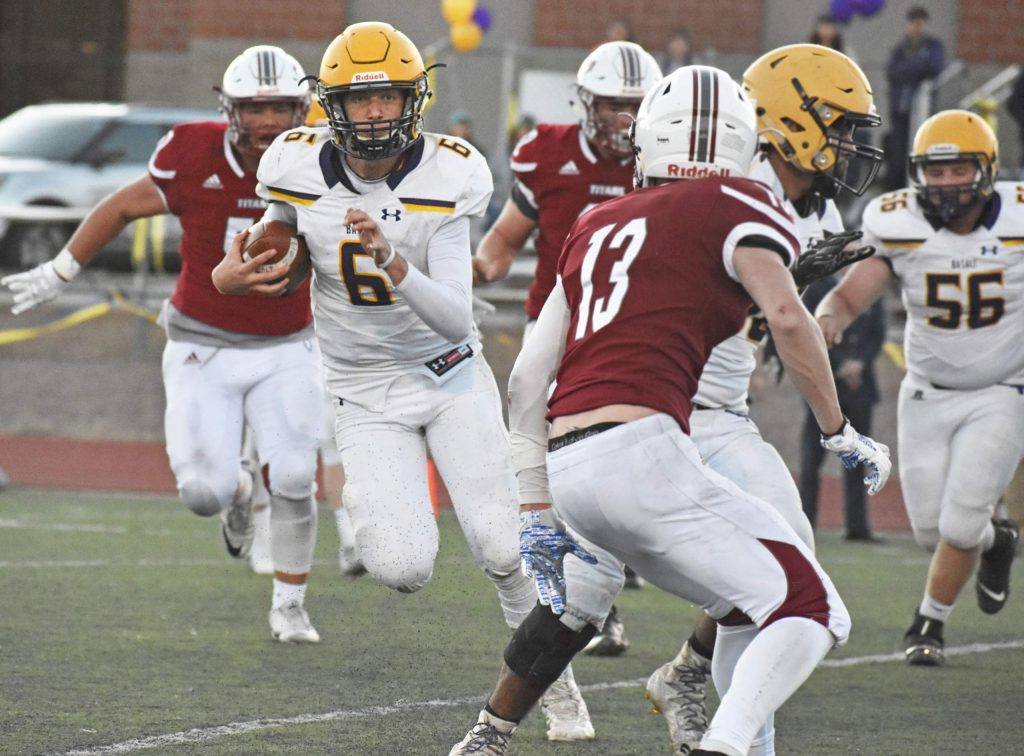Basalt quarterback Matty Gillis (6) rushes the ball during a 2A playoff game against The Classical Academy. The Longhorns defeated the Titans 13-7 on Saturday, Nov. 10, 2019 in Colorado Springs to advance to the second round of the playoffs. (Lindsey Smith, The Gazette)