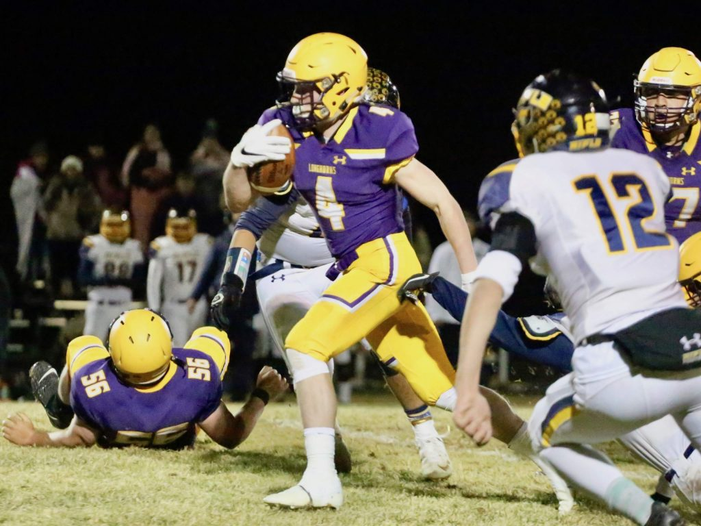 Basalt High School football's Cole Dombrowski carries the ball as BHS hosts Rifle on Friday, Oct. 25, 2019, in Basalt. (Photo by Austin Colbert/The Aspen Times)