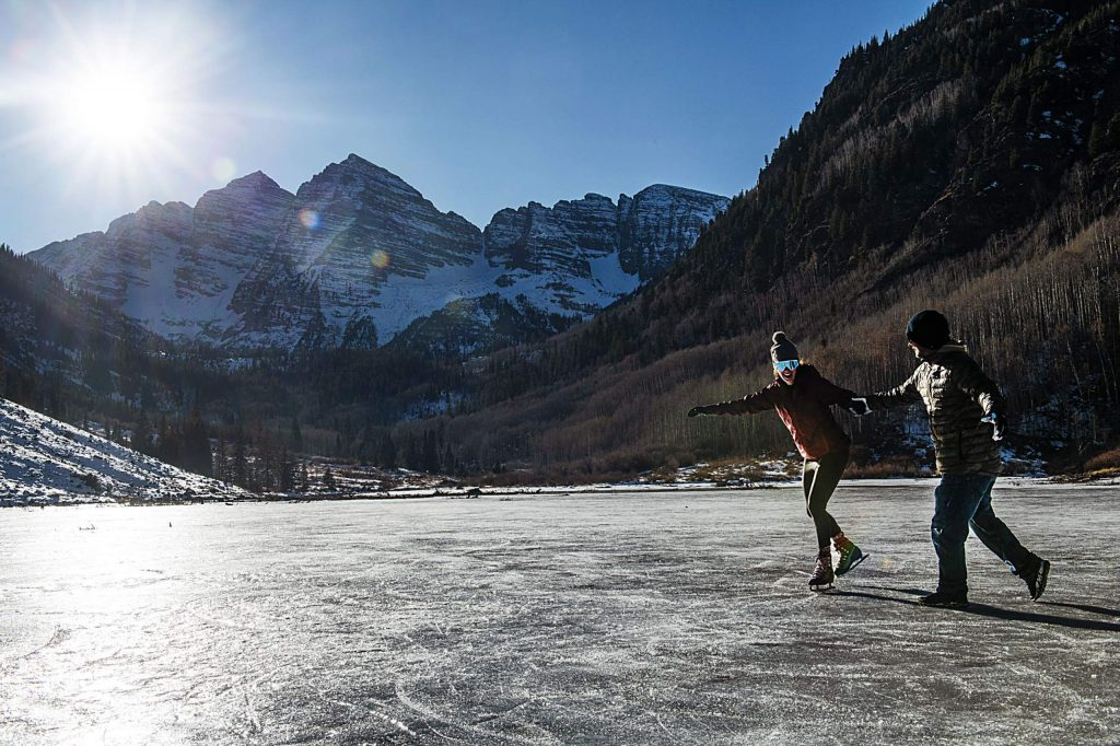 A couple skates on Maroon Lake on Thursday, the last day the popular Maroon Bells Recreation Area was open until next summer. (Kelsey Brunner/The Aspen Times)