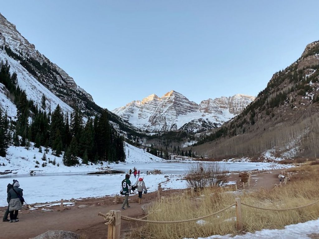 Visitors and ice skaters take in the early morning at Maroon Lake and the Maroon Bells scenic area on Sunday. The road to the lake is closed for the season but those will do hike, bike or ski up still can.