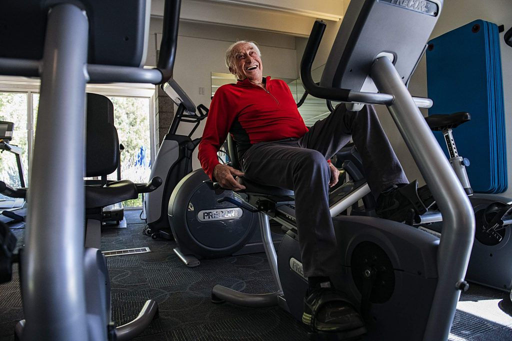 Klaus Obermeyer laughs while working out on Sept. 12, 2019.