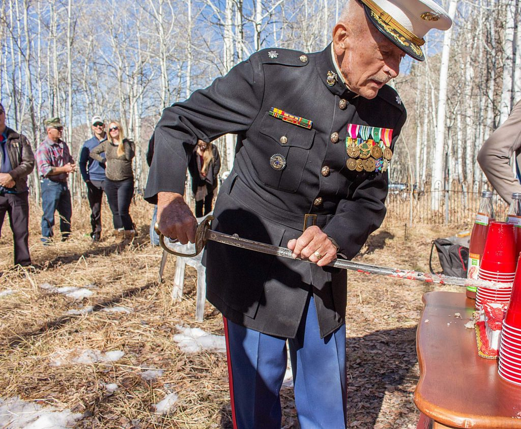 Dick Merritt, a longtime Aspen local and Marine veteran, cuts the cake for the Marines Corps birthday celebration in Aspen on Sunday, Nov. 10, 2019. Merritt served 26 years in the military and was a lieutenant colonel.