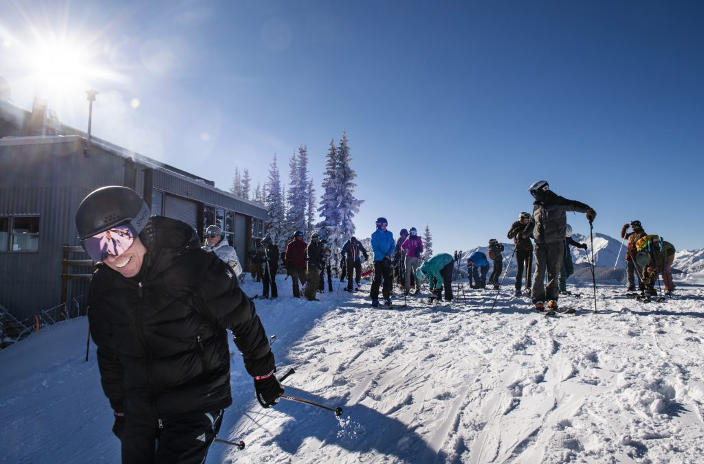 People set off down the mountain after getting off the gondola on opening day of Aspen Mountain on Saturday, November 23, 2019. (Kelsey Brunner/The Aspen Times)