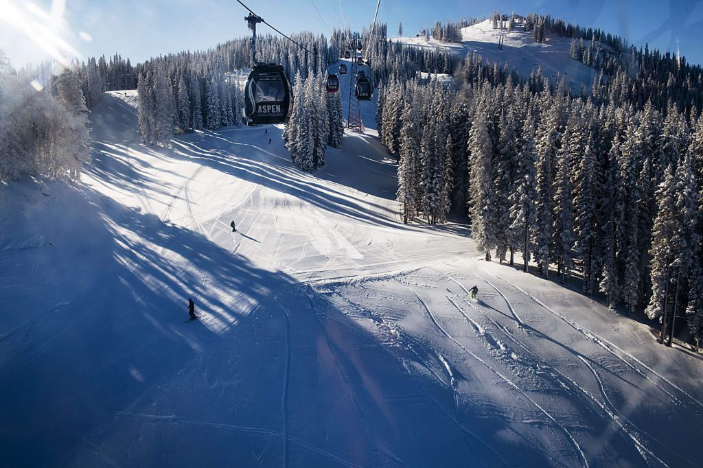 People enjoy opening day on Aspen Mountain on Saturday, November 23, 2019. (Kelsey Brunner/The Aspen Times)