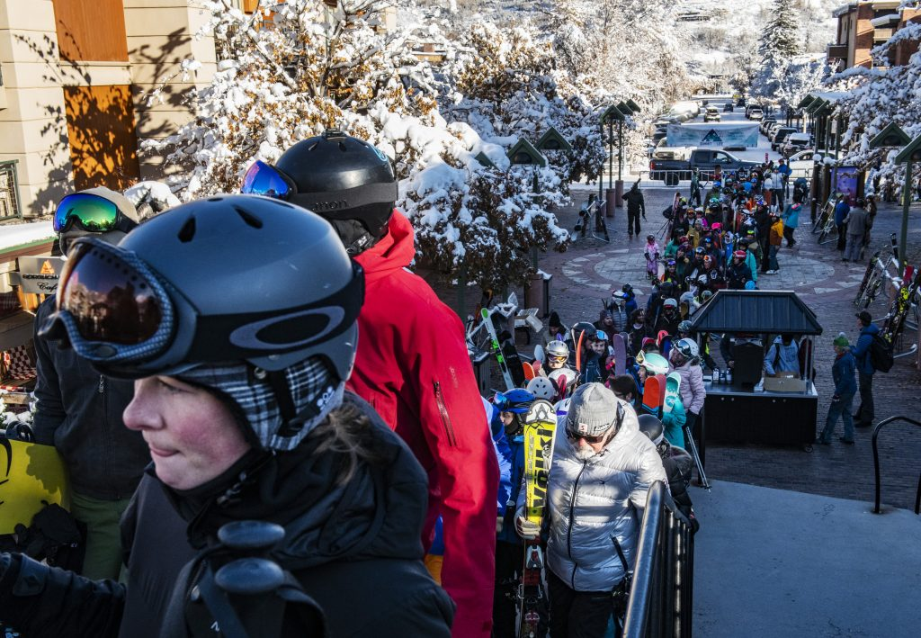 Hundreds of people wait in line to get on the Silver Queen Gondola for opening day at Aspen Mountain on Saturday, November 23, 2019. (Kelsey Brunner/The Aspen Times)