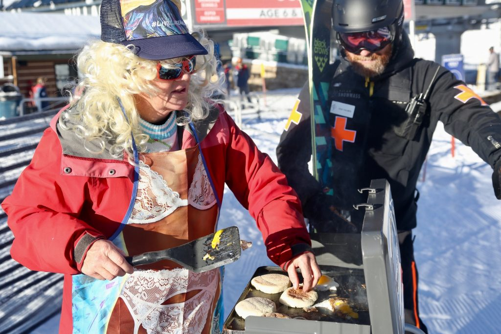 Ski patrol's Craig Chalmers waits for breakfast cooked by