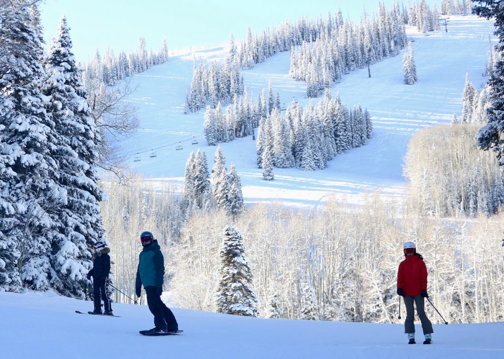 Skiers make turns during Snowmass Ski Area's opening day on Saturday, Nov. 23, 2019. (Photo by Austin Colbert/The Aspen Times)