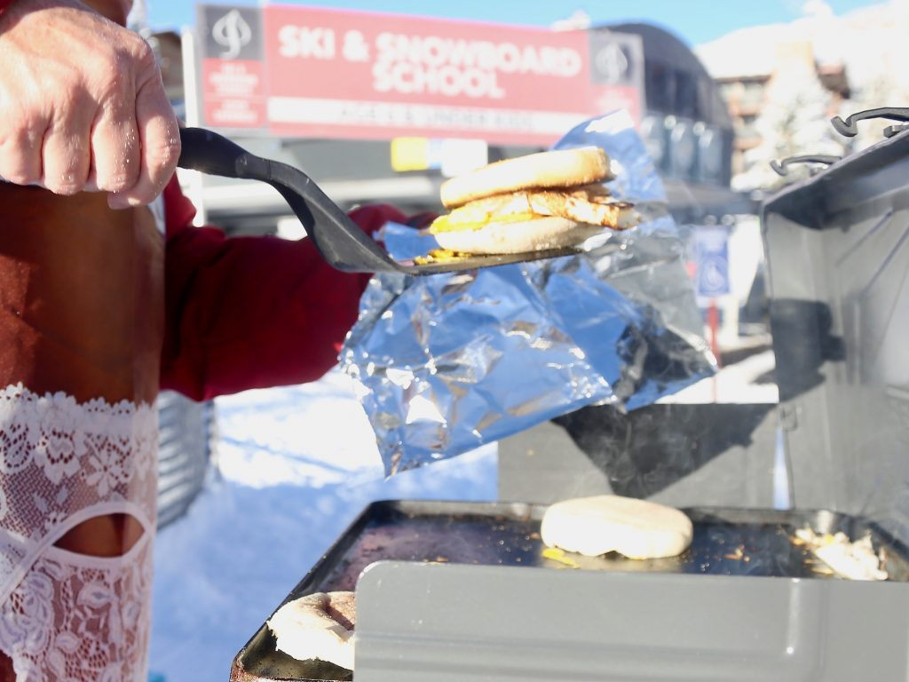 Swiller cooks breakfast sandwiches during Snowmass Ski Area's opening day on Saturday, Nov. 23, 2019. (Photo by Austin Colbert/The Aspen Times)