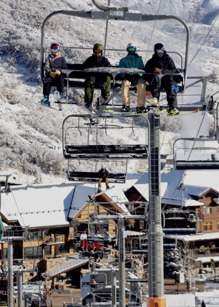 Skiers and snowboarders take the Village Express chairlift up during Snowmass Ski Area's opening day on Saturday, Nov. 23, 2019. (Photo by Austin Colbert/The Aspen Times)