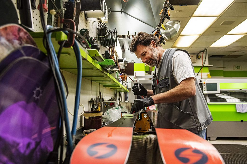 Aspen Skiing Company Tune Manager John Norman applies Phantom to the bottom of skis from the Aspen Skiing Co.'s rental fleet in the Highlands tune shop on Wednesday.