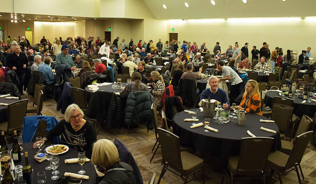 Hundreds of people line up for the annual Thanksgiving-style community potluck in Snowmass on Sunday, Nov. 24, 2019.