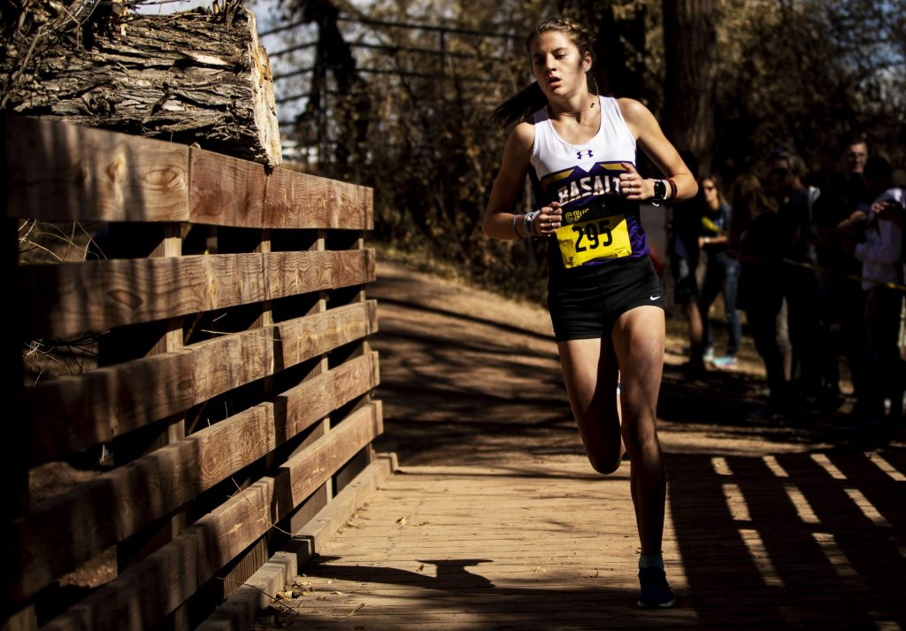 Basalt junior Sierra Bower makes her way through the first mile before finishing in first place in the Class 3A girls state championship race on Oct. 26, 2019, at the Norris Penrose Event Center in Colorado Springs. (Chancey Bush/ The Gazette)