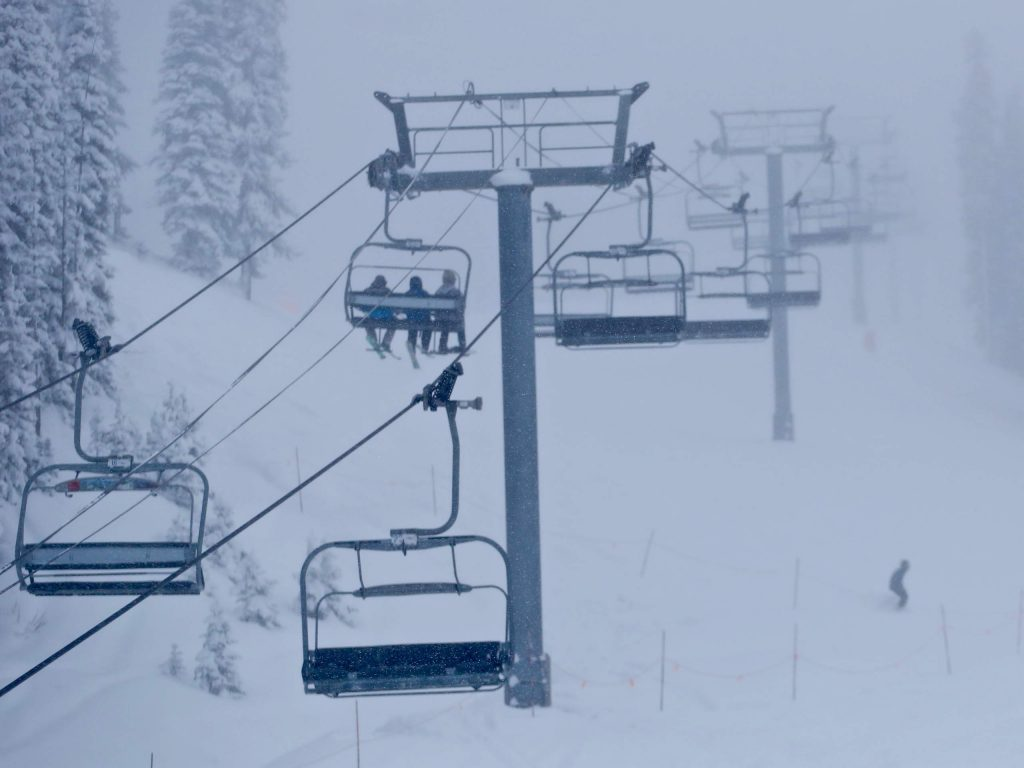 Skiers make their way up the Ajax Express chairlift on Aspen Mountain on Tuesday, Nov. 26, 2019. (Photo by Austin Colbert/The Aspen Times)