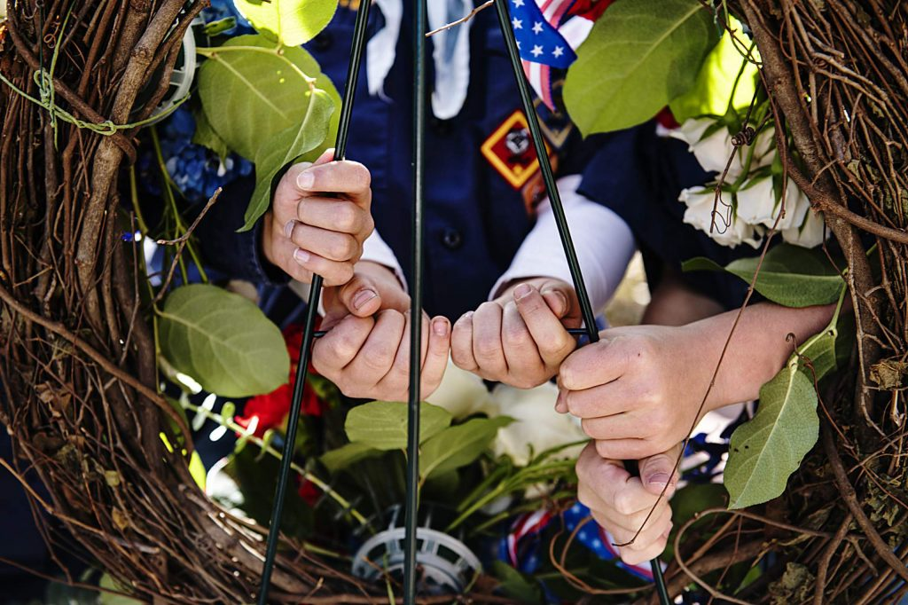 The Cub Scout Den 224 color guard prepares to pick up the wreath to present it during the Veterans Day Observance at the Veterans Memorial Park in Aspen on Monday, November 11, 2019. (Kelsey Brunner/The Aspen Times)