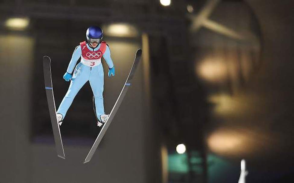 Sarah Hendrickson flies through the air above Aplensia Olympic Park in Pyeongchang, South Korea on Monday during the women's normall hill ski jumping competition at the 2018 Winter Olympics.