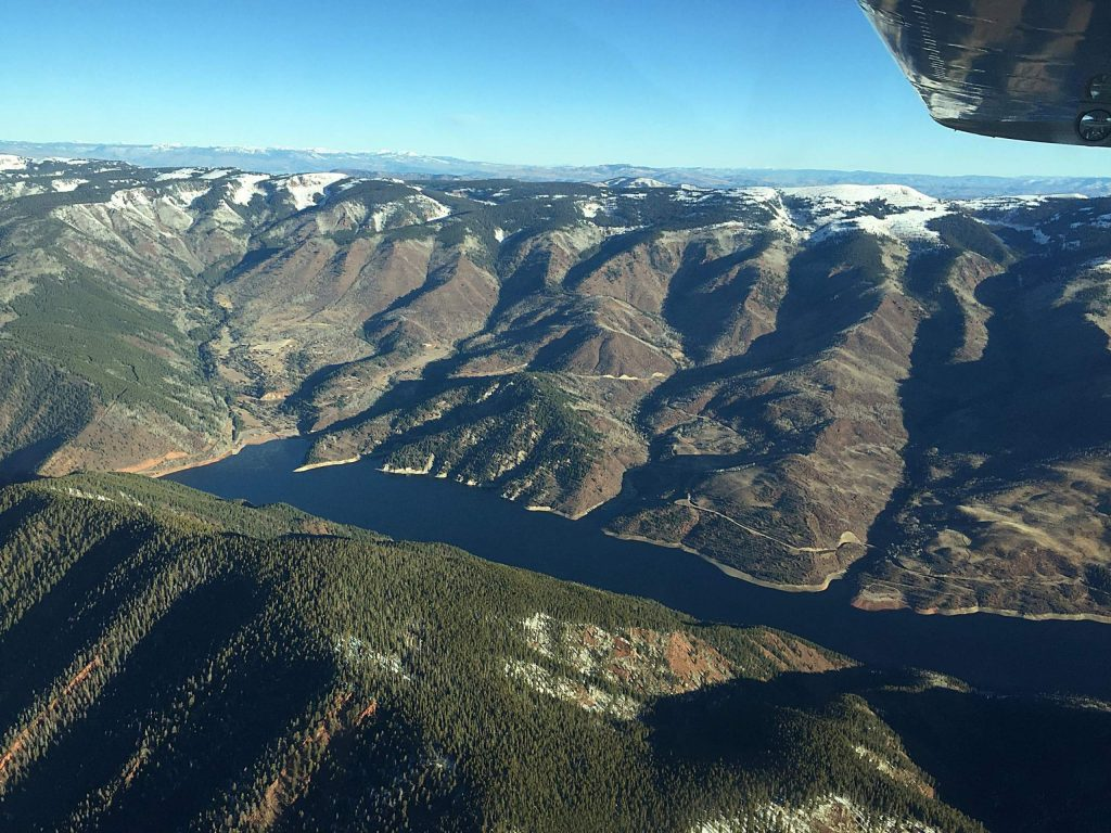 The blue expanse of Ruedi Reservoir is seen from the air with EcoFlight on Oct. 26, 2019. Students from Carbondale-based Youth Water Leadership Program got a bird's-eye view of how humans have modified water in the Roaring Fork watershed.