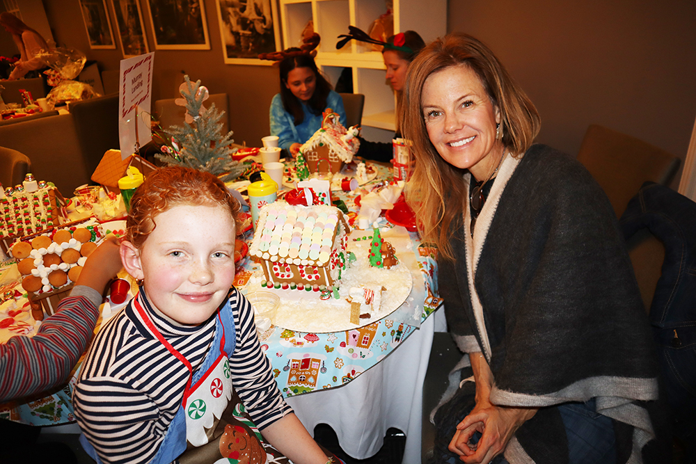 Eliza Dupps and her mom Kathy Kroger with their gingerbread creation.