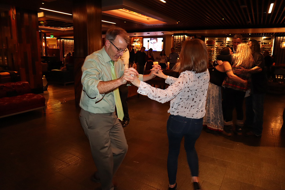 Clint Kinney takes the lead on the dance floor at a Snowmass holiday party.
