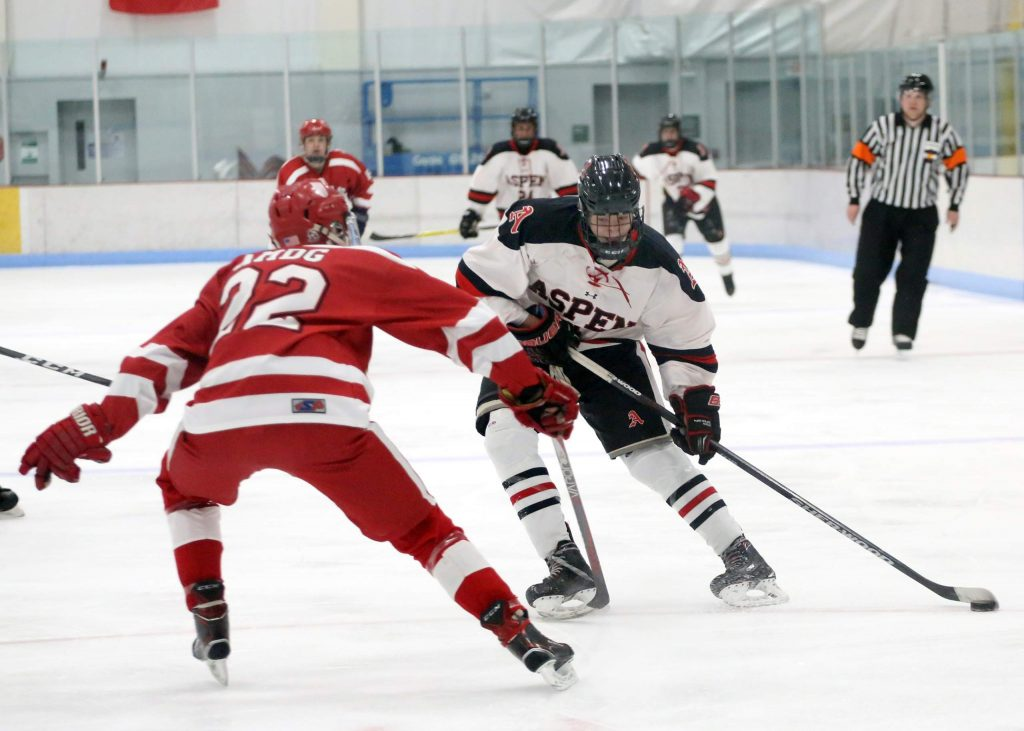 The Aspen High School hockey team plays in a game last season.