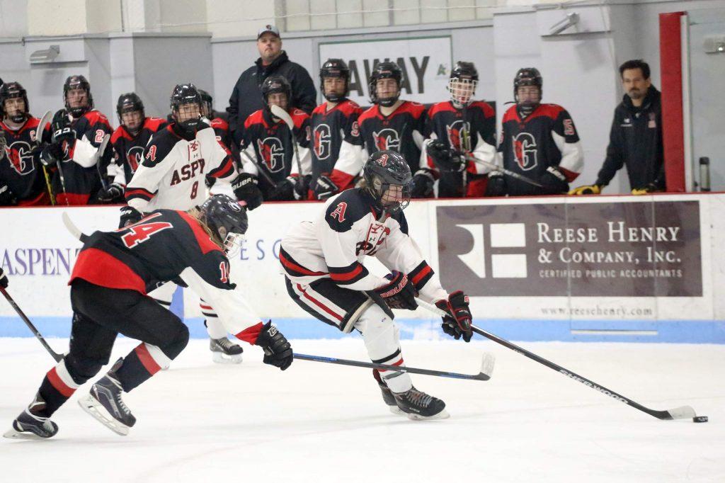 Aspen High School senior Dominic Lanese brings the puck up ice against visiting Glenwood Springs on Friday, Jan. 11, 2019, at Lewis Ice Arena.
