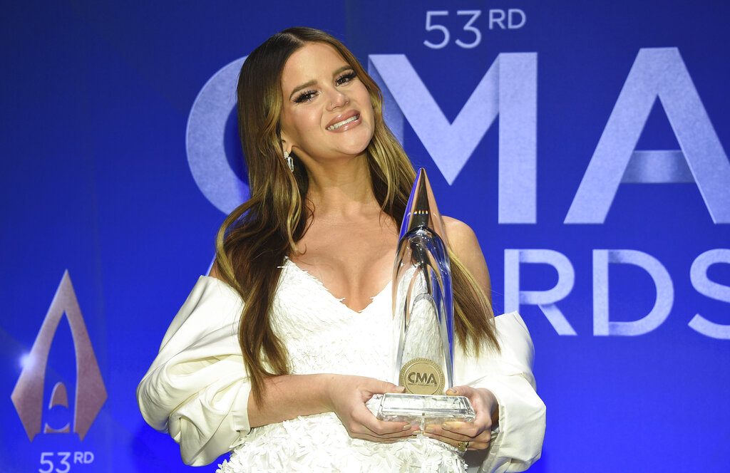 Singer-songwriter Maren Morris poses in the press room with the album of the year award at the 53rd annual CMA Awards at Bridgestone Arena on Wednesday, Nov. 13, 2019, in Nashville, Tenn. (Photo by Evan Agostini/Invision/AP)