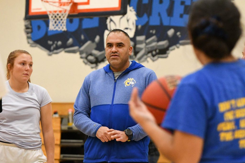 New Roaring Fork High School girls basketball coach Juan Quintero addresses the team before the start of practice at the school on Monday evening.