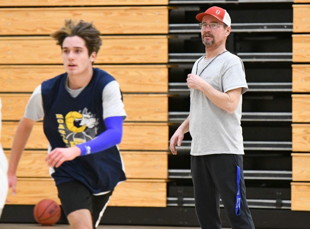 New Roaring Fork High School boys basketball coach Tony Gross watches on as the team practices at the school on Monday evening.