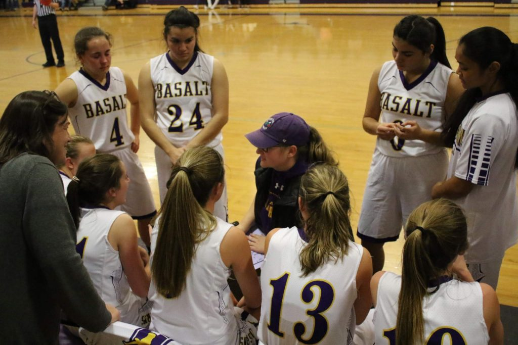 Basalt High School girls basketball coach Amy Contini talks to the team during a timeout last season. Contini is back for her second season this winter.