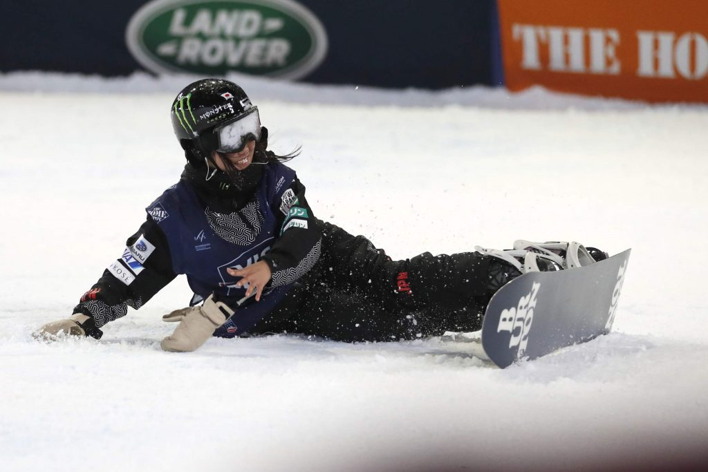 Kokomo Murase, of Japan, falls after crashing on the final jump during the finals of the Big Atlanta snowboard competition Friday, Dec. 20, 2019, in Atlanta. (AP Photo/John Bazemore)