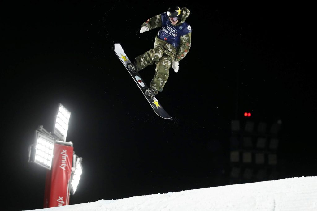 Lyon Farrell jumps during the finals of the Big Atlanta snowboard competition Friday, Dec. 20, 2019, in Atlanta. (AP Photo/John Bazemore)