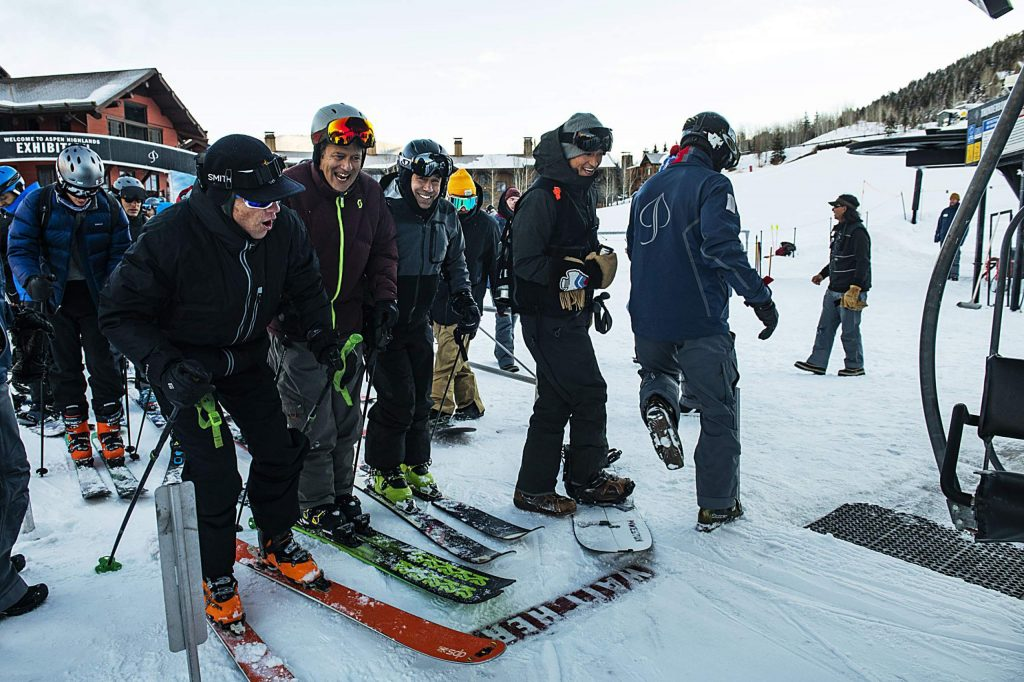 A skier maneuvers around other skiers getting on the life to snag the first chair of opening day at Aspen Highlands on Saturday, December 7, 2019. (Kelsey Brunner/The Aspen Times)