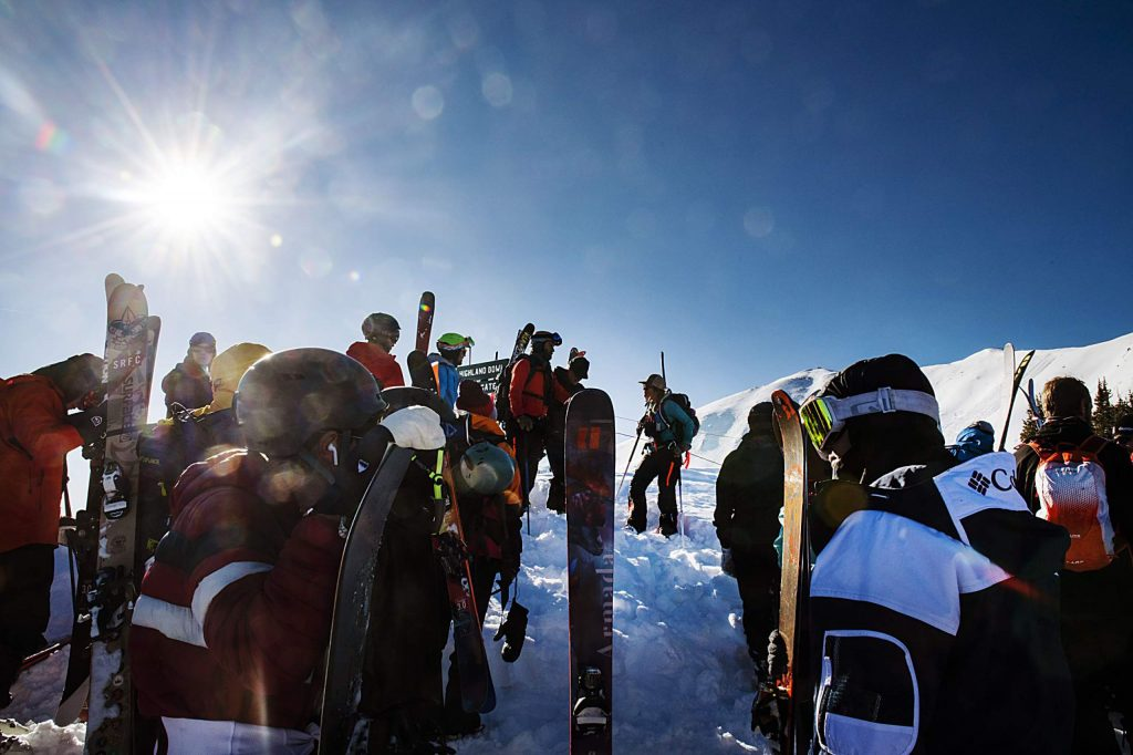 Skiers and snowboarders wait at the main gate to hike the rest of Highland Bowl during opening day at Aspen Highlands on Saturday, December 7, 2019. (Kelsey Brunner/The Aspen Times)